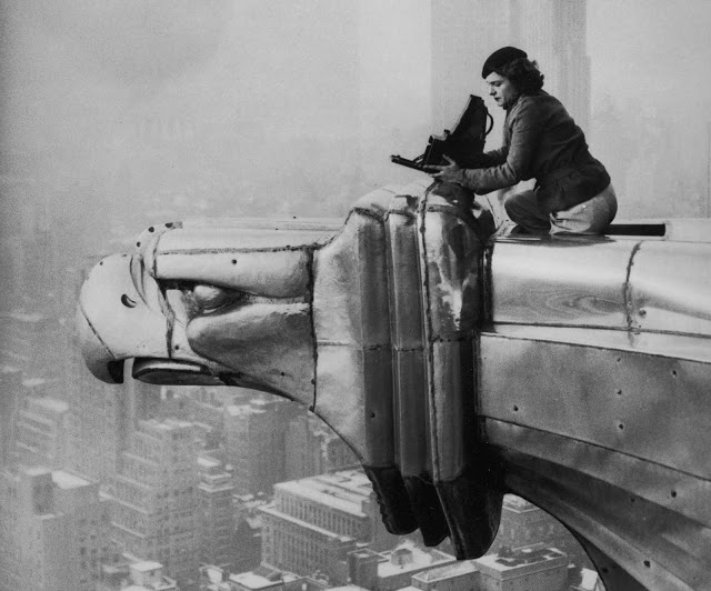 Margaret Bourke-White atop a steel gargoyle protruding from the 61st story of the Chrysler Building